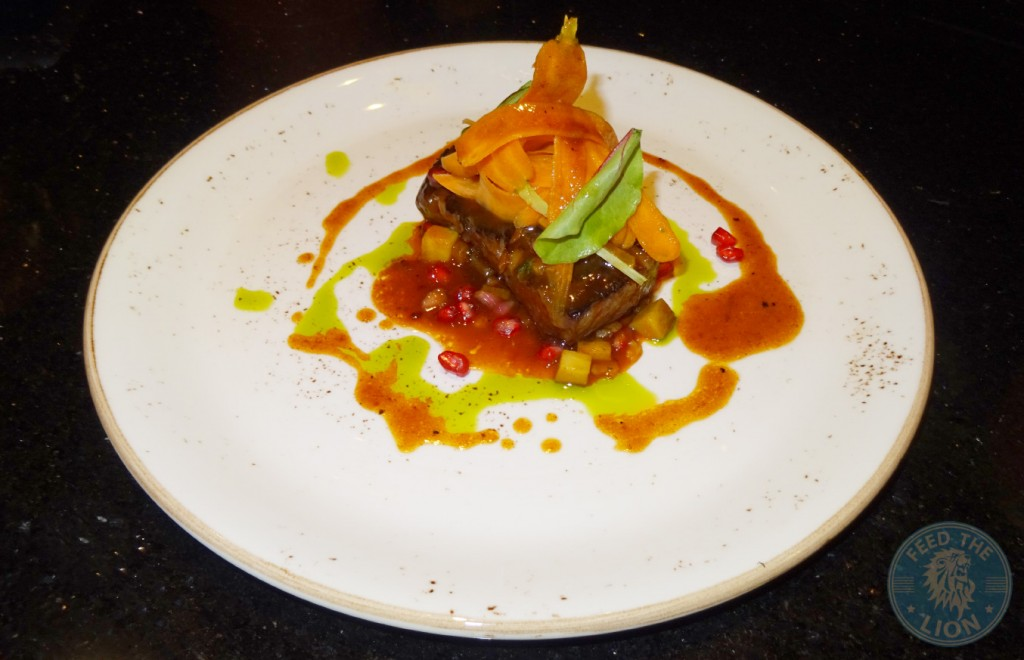 Australian Wagyu beef short rib - 48 hours cooked braised short ribs, beef gastrique, pomegrante, apricot, mint salsa Dhs 150
