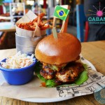 cabana SPICY MALAGUETA CHICKEN BURGER 9.95 Our Spicy Malagueta Chicken in a brioche bun, with avocado, tomato, lettuce & Malagueta Mayo. Life is good. With Fries & Slaw – 12.95