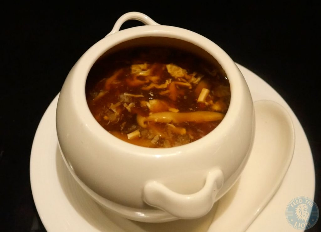 Hot and sour soup £16 Tiger prawn, chicken, cloud ear mushroom, tofu
