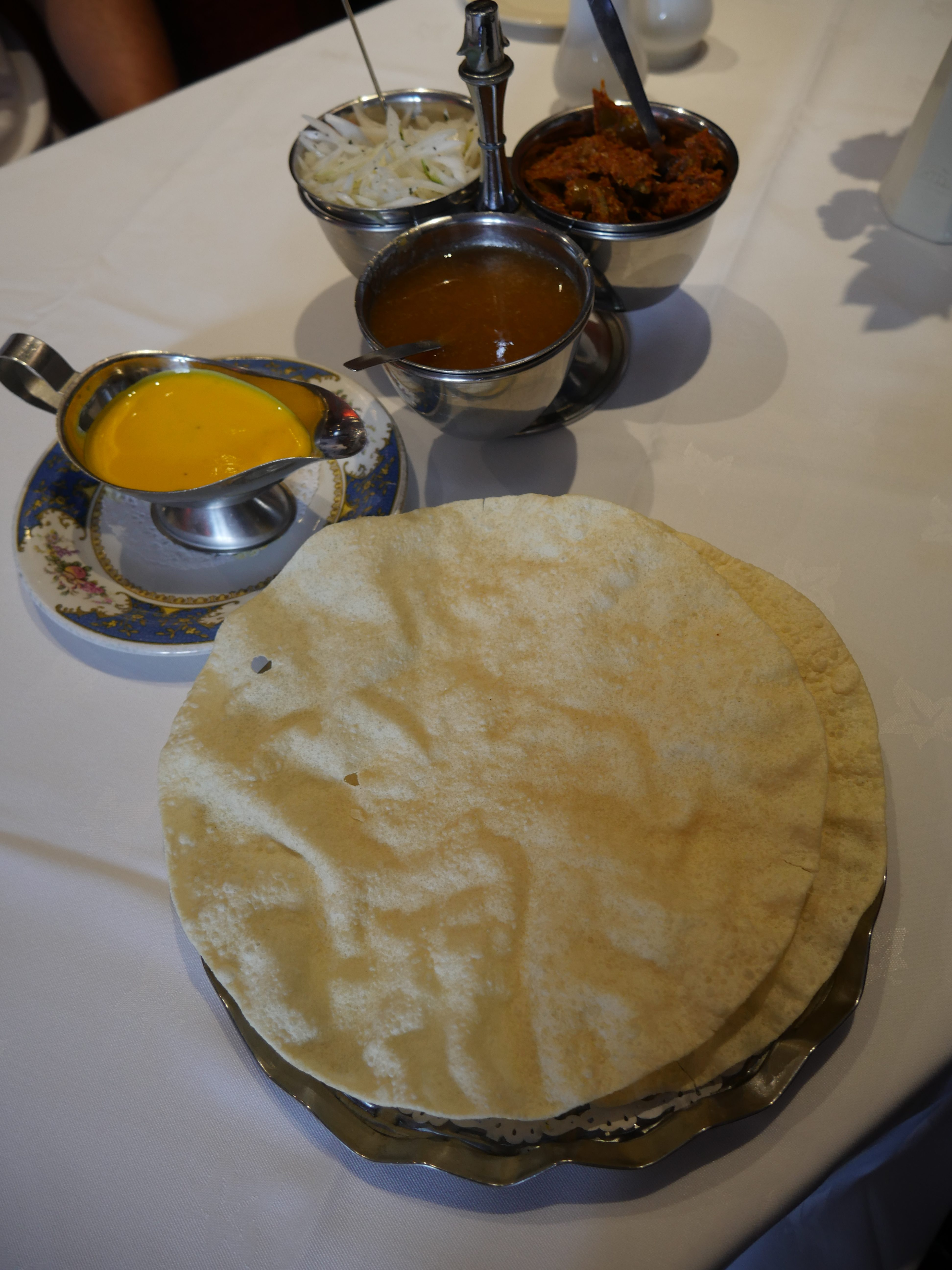 Poppadoms £0.50 with mint, mango, onion, pickle chutney dips